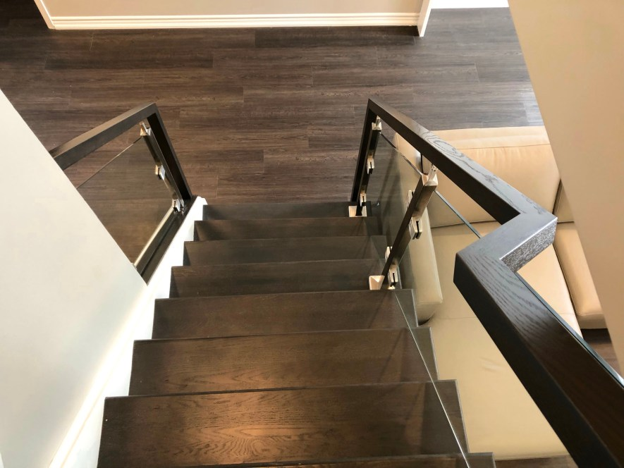 Renaissance Rail stainless steel and glass railings, square posts, stained oak handrails, on interior stairs in Grimsby, ON