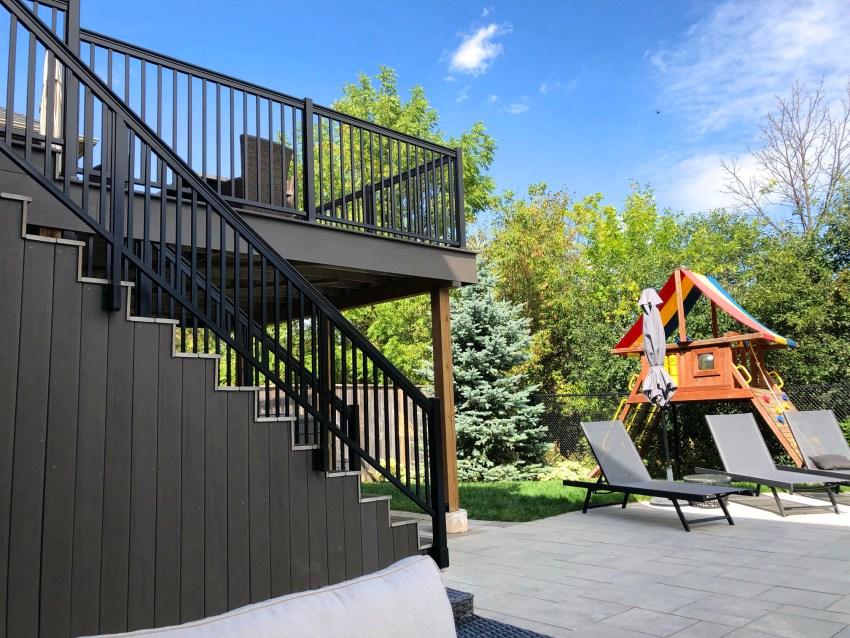 Renaissance Rail aluminum spindle railings, black, on a backyard deck in Milton, ON