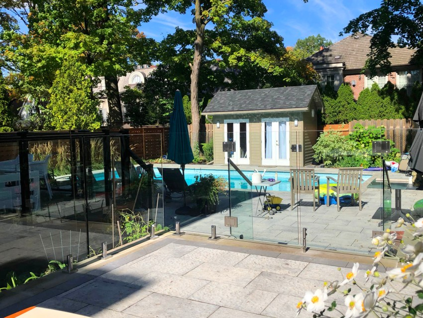 Renaissance Rail stainless steel and glass railings, spigot posts, on backyard pool patio in Toronto, ON