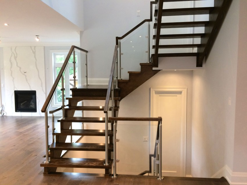 Renaissance Rail stainless steel and glass railings, round posts, oak handrails, on interior stairs in Toronto, ON