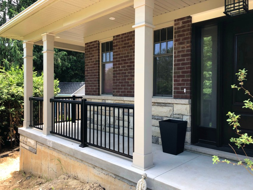 Renaissance Rail aluminum spindle railings, black, on a concrete front porch in Ancaster, ON