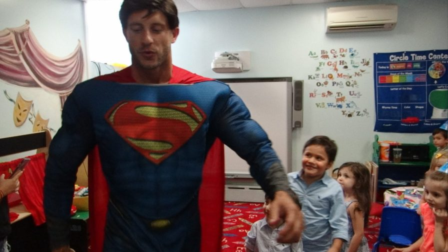 Super Man visits school birthday party