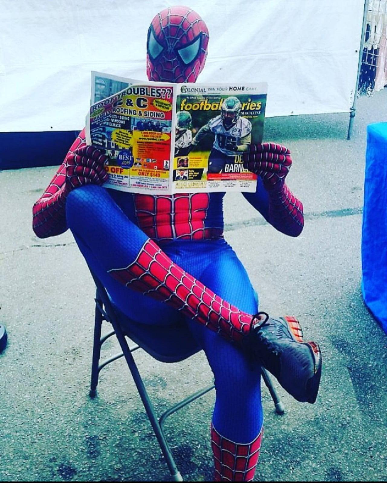 Spider Man reads paper