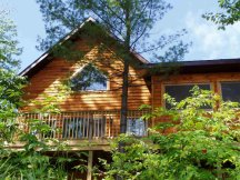 """Brand New """"2007"""" Largest Cabin with 2 BDRM & a Loft (4 Queens and 2 twins) Screen Porch, Deck, Awesome View of Lake and Beach."""
