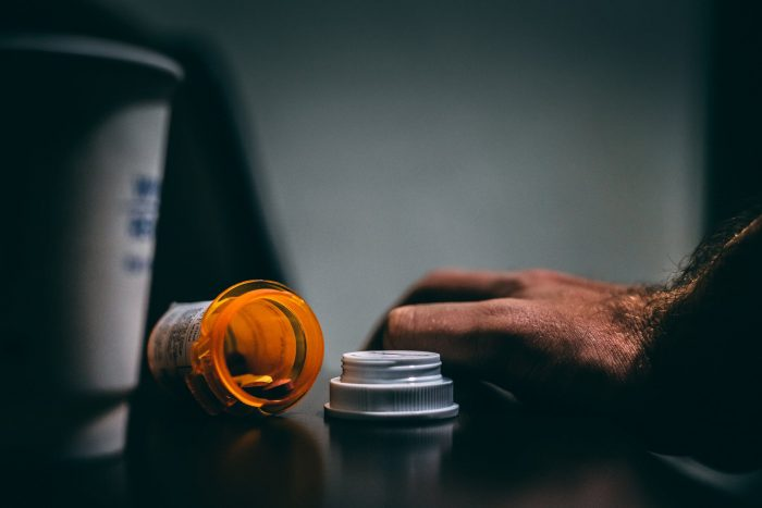 man with pill bottle