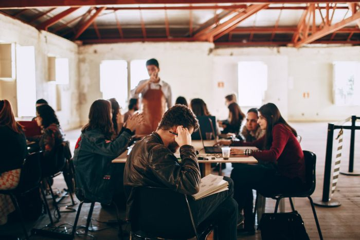 group of people working in coffee shop