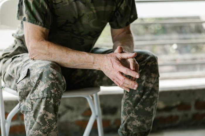 soldier with hands together