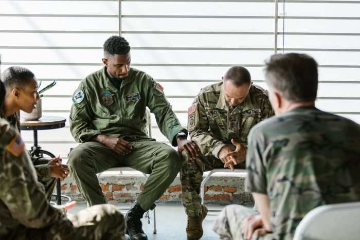 service members in group therapy