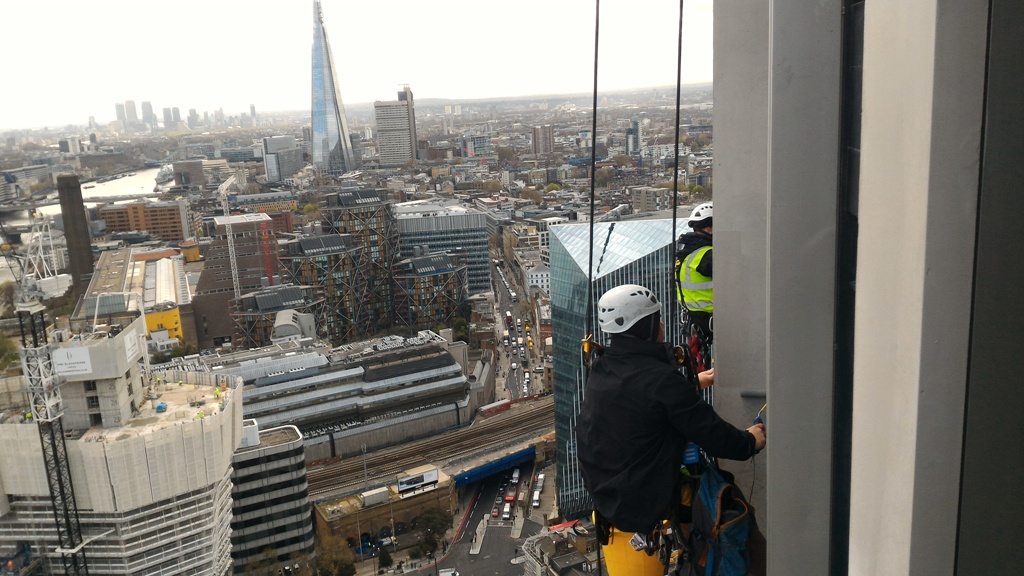 high rise GRC painting abseiling