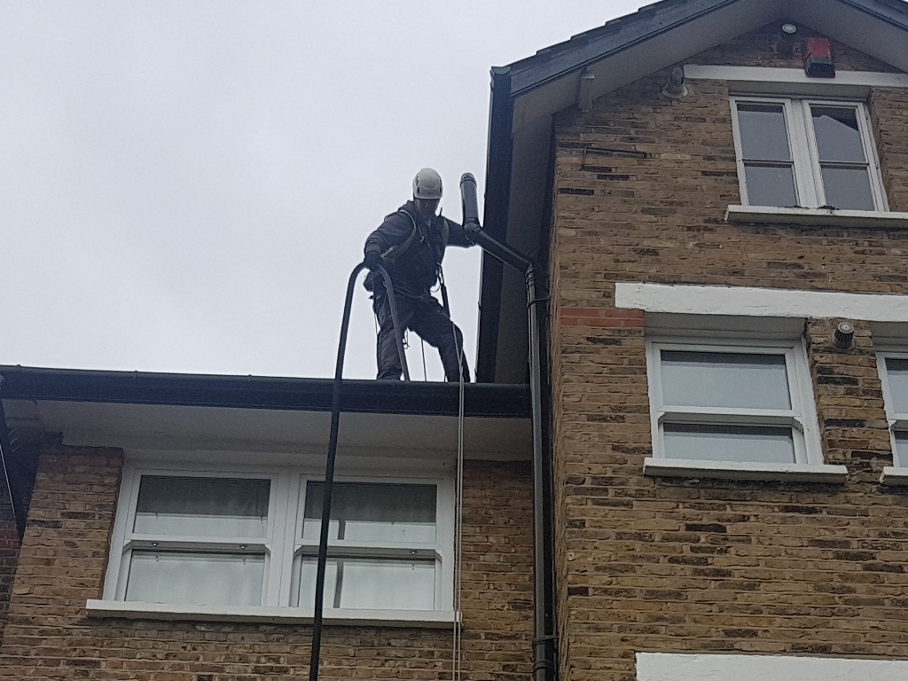 abseiling gutter hoovering