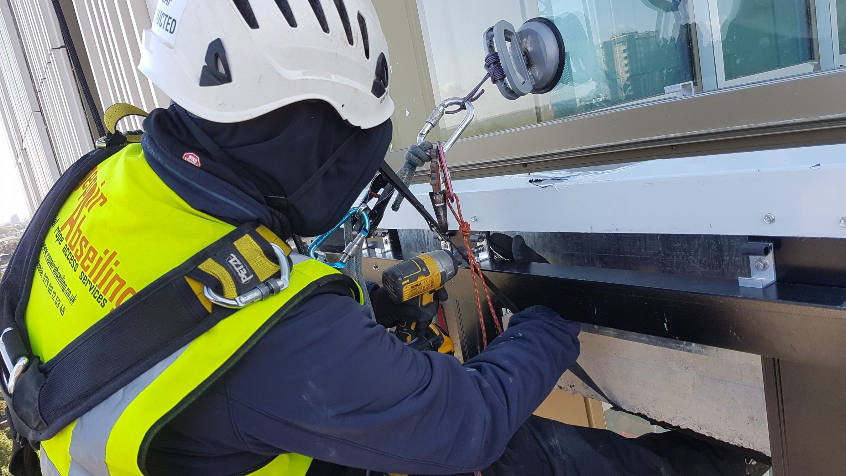 abseilers cladding installation