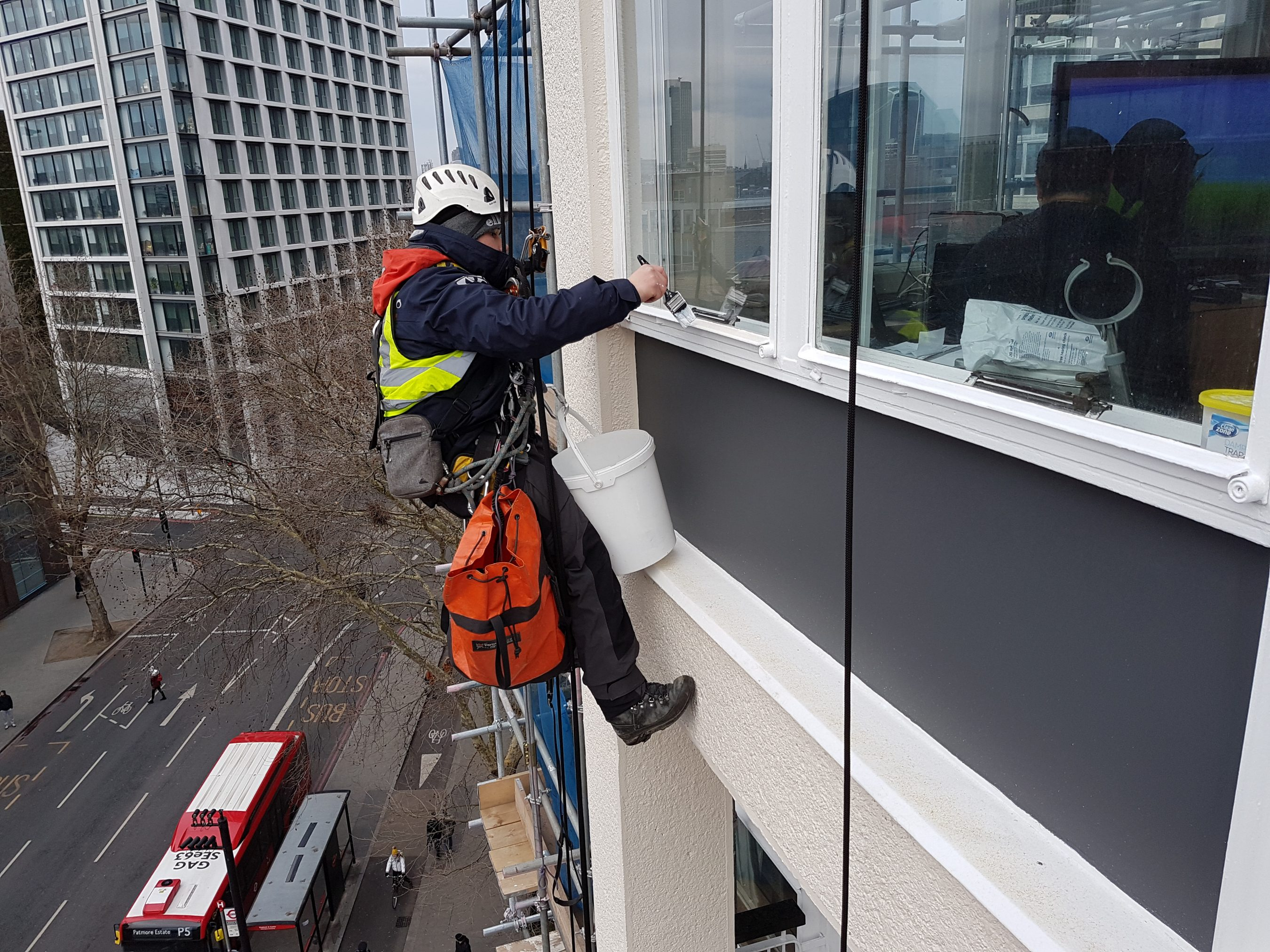 abseiling window painting