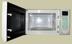 Kitchen appliances can produce damaged items in your kitchen, an uncommon appliance that can cause heat and water damage is an old microwave that does not have sufficiant amounts of space around the the vented exit of the machine.