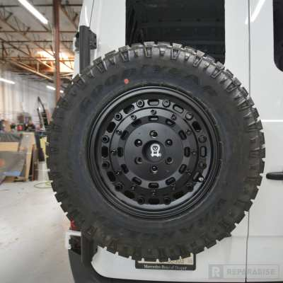 Off-road tire carrier for Sprinter Van