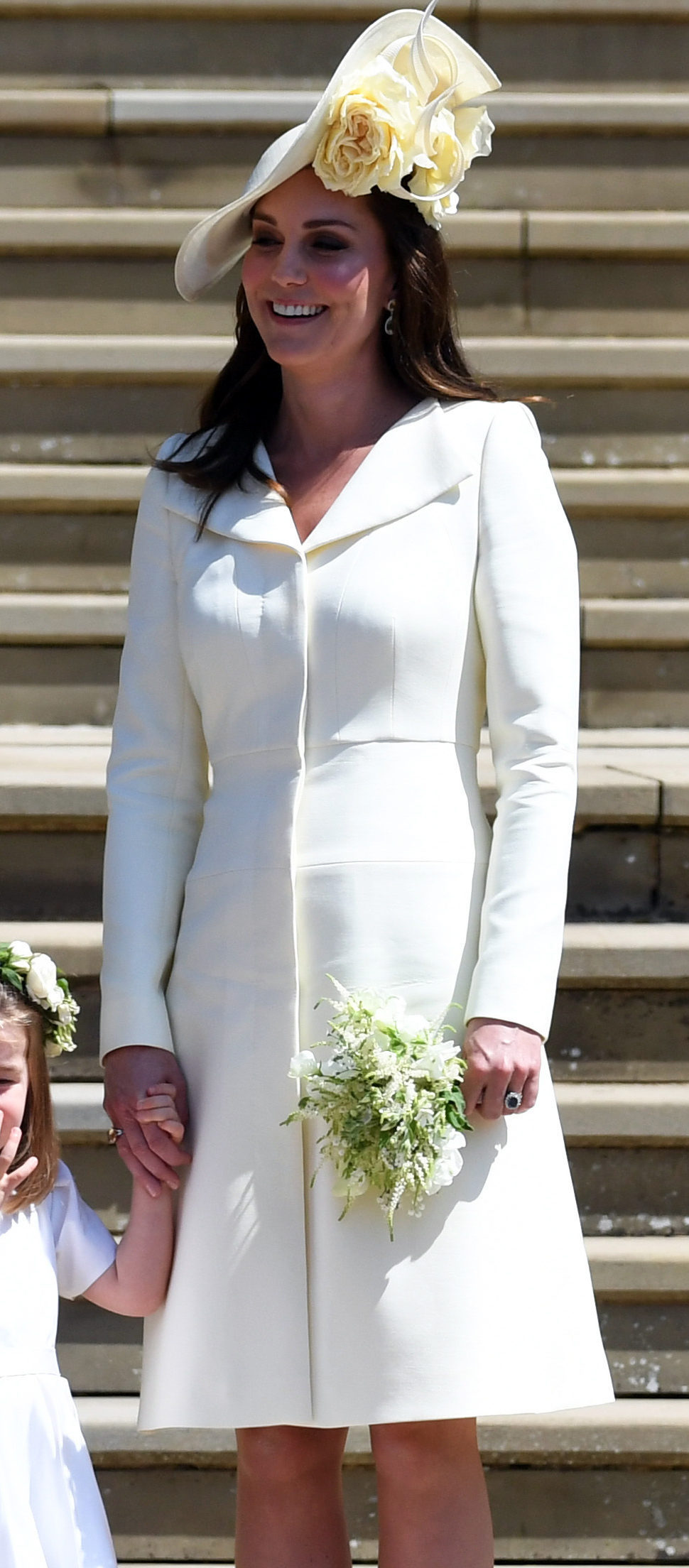 The Duchess of Cambridge chose pale yellow Alexander McQueen for Prince Harrys wedding to Meghan. Pool Photo by Neil Hall/UPI