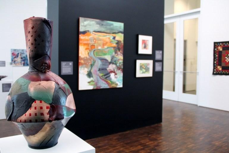 Exhibit gallery; Joel Ryser ceramic piece in foreground.