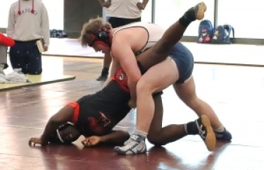 Stone Mountain's Mujahid Townes (left) and Dunwoody's Charles McCown (right) battled in the DCSD County Championships and both qualified out of sectionals for the 220 wight class in the Traditional State Wrestling Tournament this weekend. (Photo by Mark Brock)