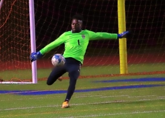 Tucker goalie Andrea Abwe and the Tigers face off with No. 1 ranked Dalton next Wednesday in the Class 6A boys' state soccer playoffs. (Photo by Mark Brock)