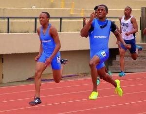 Stephenson's Bradley Favors (right) won a pair of individual gold medals (400 and 200 dashes) and was part of the gold medal winning 4x100 and 4x400 relay teams to aid the Jaguars state title win. Jace Coleman (left) won silver in the 100 and was part of the winning 4x100 and 4x400 relays.  (Photo by Mark Brock)