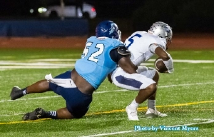Cedar Grove Preseason All-State defensive lineman Christian Miller (52) sacks Redan's Antoine Hector (5) in the Saints win last week. Miller and his Cedar Grove teammates travel to take on No. 7 ranked Lowndes on Friday. (Photo by Vincent Myers)
