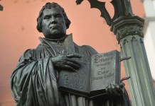 WITTENBERG, GERMANY - OCTOBER 20: A statue of 16th-century theologian Martin Luther stands on Marktplatz square on October 20, 2016 in Wittenberg, Germany. In 1517 Luther nailed his 95 theses to a door of the nearby Schlosskirche Church. Next year will mark the 500th anniversary of the Reformation that Luther set in motion and that led to the creation of successful Protestant movements in history's most significant challenge to the Catholic Church. Celebrations and events in Germany will begin later this month and continue globally through next year. Luther's translation of the Bible made it accessible to a much broader audience. He also spoke out against the practice of indulgences and the sale of relics, and also argued that a place in Heaven is possible not by good deeds but through faith. (Photo by Sean Gallup/Getty Images)