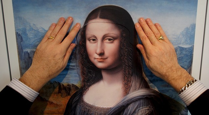 MADRID, SPAIN - FEBRUARY 10: A blind person feels with his hands a copy of 'La Gioconda from Da Vinci's workshop' at The Prado Museum on February 10, 2015 in Madrid, Spain. 'Hoy toca el Prado' (Touch The Prado) allows blind or vision-impaired visitors to explore with their hands the copies of six masterworks. The copies were created using a technique called 'Didu' which provides texture and volume to the paintings. (Photo by Pablo Blazquez Dominguez/Getty Images)