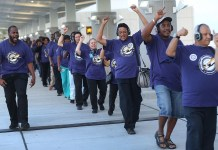 FORT LAUDERDALE, FL - NOVEMBER 19: Fort Lauderdale-Hollywood Airport workers, some of whom are cabin cleaners, baggage handlers, ramp workers, wheelchair attendants, janitors, and other passenger service workers employed by two airline service contractors, Eulen America and AirServ, picket together on November 19, 2015 in Fort Lauderdale, Florida. The striking workers were part of a nationwide airport workers strike calling attention to what they say are the companies unfair labor practices, unaffordable benefits and low-wages. (Photo by Joe Raedle/Getty Images)