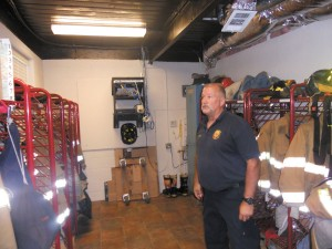Captain Steven Gamble shows off the renovated locker room at Fire Station 27. The station is slated for tear down by the city of Atlanta.