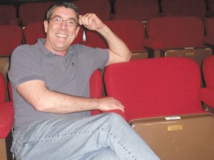 Robert Egizio, producing artistic director of Dunwoody's Stage Door Players, relaxes in the theater.