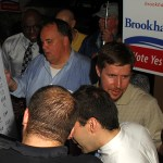 Brookhaven YES supporters await voting results from DeKalb County at Pub 71 on July 31.