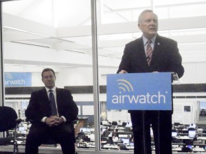 AirWatch chairman Alan Dabbiere, at left, listens as Gov. Nathan Deal praises the high-tech company's expansion.