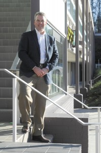 Michael Blair, managing director for development for Pollack Shores Real Estate Group, stands at a shopping center the company will replace with a luxury apartment complex. The complex is one of two planned at Hammond Drive and Peachtree Dunwoody Road in Sandy Springs.