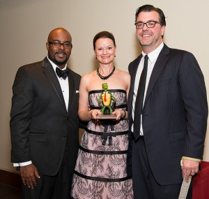 Sandy Springs/Perimeter Chamber of Commerce chairman Cory Jackson, left, with Katie and Geoff Melkonin, owners of Breadwinner Cafe. They won the chamber's 2013 'Sandy' award for restaurant of the year.
