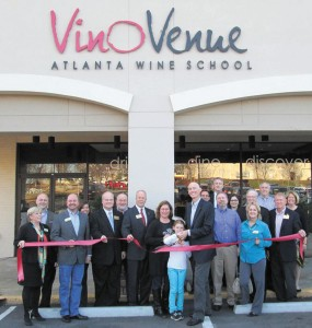 Willa Bryan, center, along with parents Lelia Bryan, left, and Michael, right, cut the ribbon on Vino Venue in Dunwoody's Georgetown Shopping Center. The opening festivities attracted city officials and members of the   Dunwoody Chamber of Commerce.