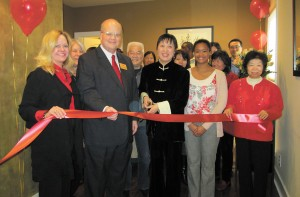 Absolute Holistic Medicine, an alternative medicine clinic located at 1868 Independence Square in Dunwoody, recently held a ribbon cutting on Feb. 13, marking its grand opening. From left, Sara Massey, representing the Dunwoody Chamber of Commerce, Dunwoody City Councilman Terry Nall, Dr. Jitao Bai, owner, Charln Chou and Cindy Wang, were joined by representatives from the Atlanta Chinese Culture Center and Atlanta Chinese Christian Church.