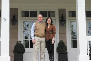 Steve Dickson and his wife Paula stand on the porch of their home on North Wood Valley Road. Dickson is a member of the West Paces/Northside Neighborhood Association's board of directors.