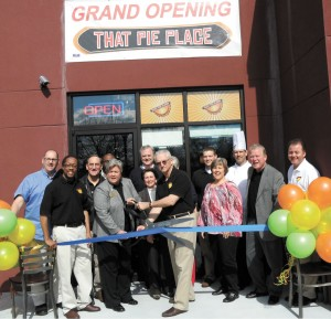 That Pie Place, located at 6355 Peachtree Dunwoody Road in Sandy Springs, opened its doors in February.  Sandy Springs Councilwoman Dianne Fries, left,  and owner Ron Wolf, right, cut the ribbon, surrounded by Sandy Springs/Perimeter Chamber of Commerce Ambassadors,  business associates and friends.