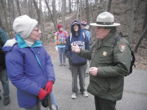 Jackie Miller, left, chats with National Park Service Ranger Jerry Hightower, right, at the Chattahoochee River National Recreation Area, while Marie deVenoge, center, listens in.