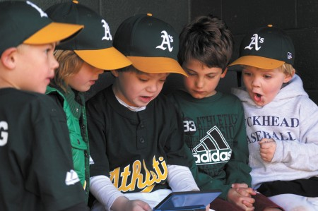 Before hitting the field for Buckhead Baseball's Opening Day festivities to mark the start the season at Frankie Allen Park, Brooks Bowling (from left), Hugh Carter, Billy Gingrey, Bryce Bowling and Luke Gingrey enjoyed another beloved pastime of the modern generation — video games. The Athletics are coached by Brian Bowling in the T-ball 5-year-old league.