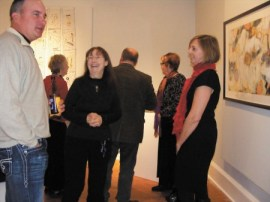 Brad Little, left, chats with Barb Rehg and Linda King during the opening of the 'Formations' show at the Spruill Gallery in Dunwoody. The show includes works by six Georgia artists.