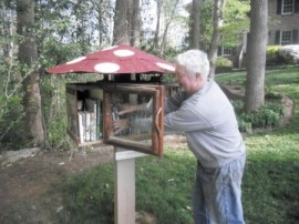 G. Michael Smith checks on his mushroom-shaped 'little library' on Witham Drive in Dunwoody.