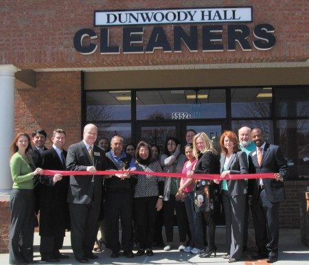 Dunwoody Hall Cleaners returned to its original space at 5552A Chamblee-Dunwoody Road in Dunwoody after moving into another building during area construction. Their move was noted by the Dunwoody Chamber of Commerce with a ribbon-cutting ceremony, attended by, from left, Heather Kaufman, Juan Diego, Randy Aufleger, Dunwoody City Councilman Terry Nall,  Beal, Nash Amlani, owner, Indu, Shamin Amlani, Jovana, Fauzia Amlani, Norman Collins, Carmen, Sara Massey, Paula Owens, Glen Fuse and Ken Manous.