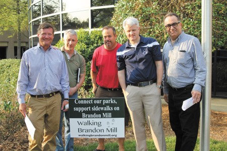 From left, Chad Plumly, Cortne Pappas, Tom Hayes, John Schneider and Dan Berger, members of the Walking Brandon Mill Coalition.