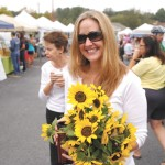 Heather Walker purchases flowers at the Sandy Springs Farmers Market.