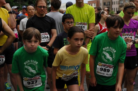 At the starting line, left to right, Justin Smith, Grace Hogan, and Ethan Sumner, all 5th graders at Ashford Park Elementary, await the starting signal.