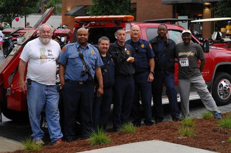 Ronnie Mayer, left, and firefighters from the the DeKalb Fire Department station in Brookhaven watch out for runners.