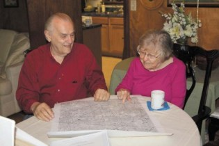 Albert and Virve Martin look at an old map of DeKalb County at their Pine Hills home.