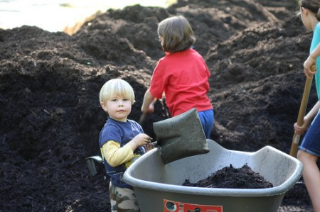 Nathan Turner helps fill a wheelbarrow with soil along with other Friends of Briarwood Park April 25. Photo By: Melissa Weinman
