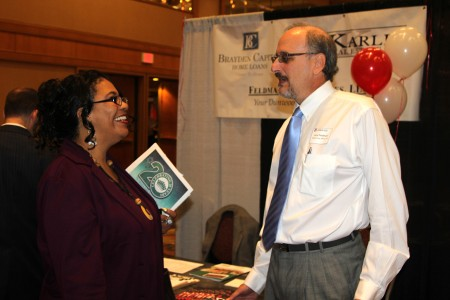 Gayle Warren of LegalShield, chats with Dunwoody closing attorney Larry Feldman at the Feldman Law Offices booth at the Greater Perimeter Business Expo on May 2.