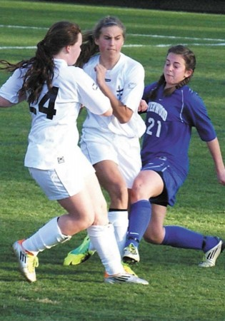 Emma McCabe, right, says soccer has taught her lifelong skills she can put to use on and off the field.